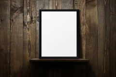 Blank poster over wooden background Royalty Free Stock Photo
