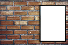 Blank poster photo frame on vintage brick wall Royalty Free Stock Image