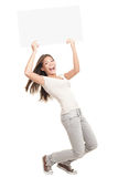 Blank poster sign woman excited. Poster sign woman excited standing in full length - funny and energetic pose. Young Caucasian / Asian female model isolated on Stock Photos