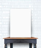 Blank poster on vintage wooden table at brick tiles wall,Templat Stock Photos