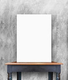 Blank poster on vintage wooden table at concrete wall,Template f. Or add your content royalty free stock images