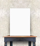 Blank poster on vintage wooden table at concrete wall,Template f. Or add your content royalty free stock image