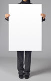 Blank poster. Woman holding a blank poster Stock Photos