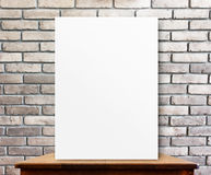 Blank poster on wood table at brick wall,perspective background Royalty Free Stock Photo