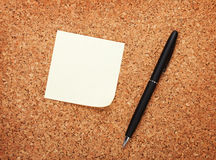 Blank postit note on cork notice board Royalty Free Stock Images