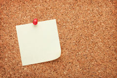 Blank postit note on cork notice board Stock Photo