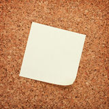 Blank postit note on cork wood notice board Royalty Free Stock Image