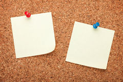 Blank postit notes on cork notice board. Blank postit notes on cork wood notice board Stock Photo