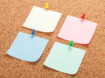 Blank postit notes on cork notice board Royalty Free Stock Photography