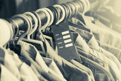 Blank price label on clothes hang on a shelf in a fashion store Royalty Free Stock Photography