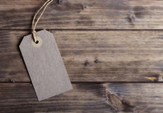 Blank price tag. On the background of wooden planks Stock Photo