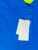 Blank price tag hang over blue  t-shirt Royalty Free Stock Image