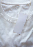Blank price tag hang over t-shirt Stock Images