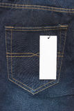 Blank price tag on jeans Royalty Free Stock Photo