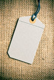 Blank price tag label on burlap background Stock Photography