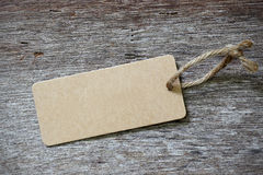 Blank price tag label on wooden Stock Photos