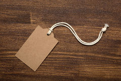 The blank price tag label on wooden background Stock Images