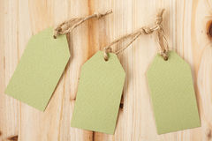 Blank price tags on a wooden background Stock Images