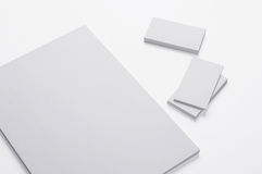 Blank A4 print paper and Business cards  on white. Background with soft shadows / Stationary Royalty Free Stock Photo