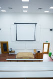 Blank projection screen in the lecture hall. High angle view of blank projection screen in the lecture hall stock photography