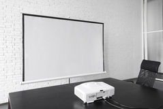 Blank projector canvas in the office Royalty Free Stock Image
