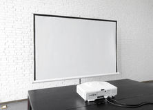 Blank projector canvas in the office Royalty Free Stock Photography