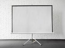 Blank projector canvas in the office. Blank projector canvas shot in the office Stock Photo