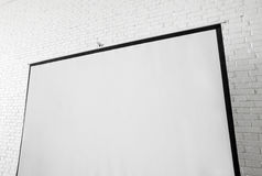 Blank projector canvas in the office. Blank projector canvas shot in the office Stock Photography