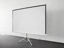 Blank projector canvas in the office. Blank projector canvas shot in the office Stock Image