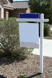Blank property for sale sign. Blank for sale property sign in front of house Royalty Free Stock Photo