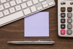 Blank purple paper on workspace for note Stock Images