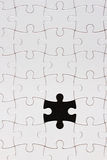 Blank puzzle on black background Stock Image
