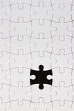 Blank puzzle on black background. Blank white puzzle on black background Stock Image