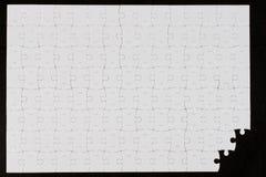 Blank puzzle on black background. Blank white puzzle on black background Stock Photos