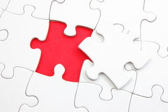 Blank puzzle with missing piece. Blank and white puzzle with missing piece stock photography