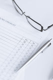 Blank questionnaire or form with eyeglasses Royalty Free Stock Images