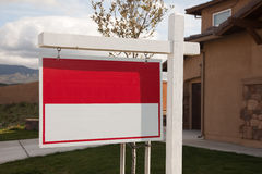 Blank Real Estate Sign in Front of House stock photo