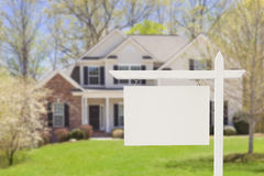 Blank Real Estate Sign in Front of New House Royalty Free Stock Photos