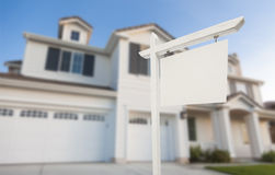 Blank Real Estate Sign in Front of New House Stock Image