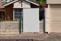 Blank real estate sign outside an suburban residential property stock photos