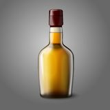 Blank realistic whiskey bottle isolated on grey Royalty Free Stock Image