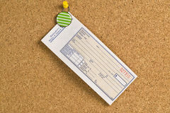 Blank receipt hanging on a bulletin board Stock Photography
