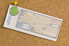 Blank receipt hanging on a bulletin board Royalty Free Stock Photography