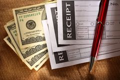 Blank receipt, money and pen Royalty Free Stock Image