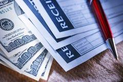 Blank receipt, money and pen Stock Photo