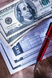 Blank receipt, money and pen Stock Photos