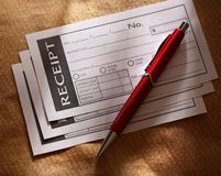Blank receipt and pen Stock Photography