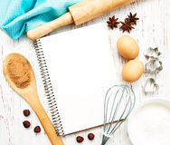 Blank recipe book. With baking ingredients on a old wooden background Stock Image
