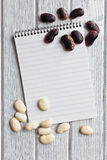 Blank recipe book with beans Stock Photography