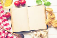 Blank recipe book and fresh ingredients. The blank recipe book and fresh ingredients Royalty Free Stock Photography